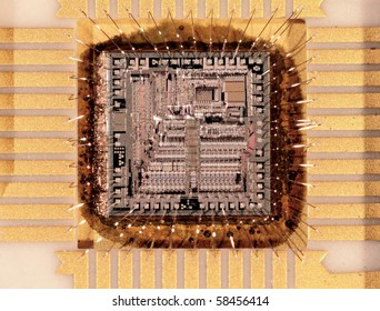 Microcircuit crystal the size 4x4mm, close up at substantial magnification