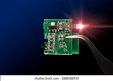 Microcontroller circuit board with infrared led light emitting diode electronic part closeup