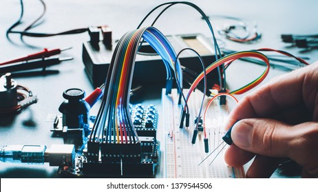 Microcontroller innovation. Hardware engineering hobby. Electronic breadboard components. Programmer smart home hobby.