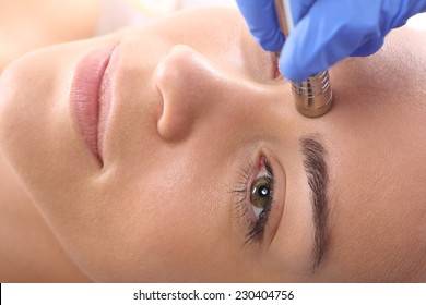 Microdermabrasion .Relaxed woman during a microdermabrasion treatment in beauty salon