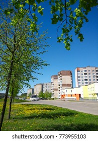 microdistrict housing estate behind a field of dandelions under
