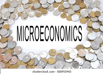 microeconomics word on white blank with framing Indonesian coins money