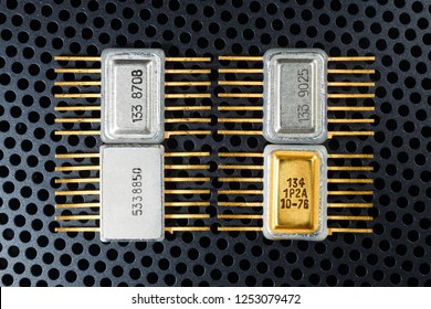 Microelectronics components close-up. Golden electronic chips.