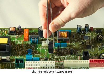 microelectronics engineering and technology concept. Electronic board. Detail for electronic circuit board and tweezers. smd electronic components assembling. engineering education.