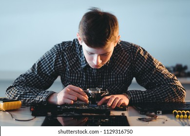 microelectronics workshop courses. computer repair. technician or student inserting socket into motherboard