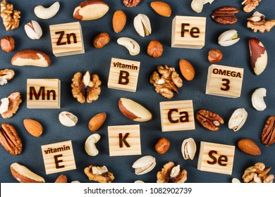 Microelements and vitamins in different types of nuts. Healthy food concept
