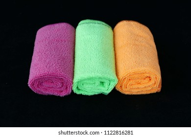 microfiber cleaning cloths in orange color, black back ground,colored microfiber cleaning cloths,