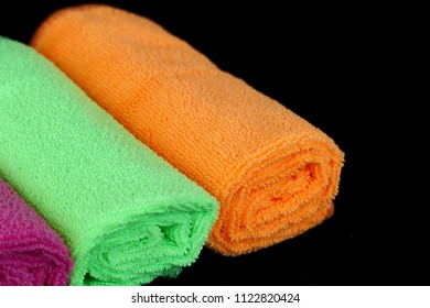 microfiber cleaning cloths in orange color, black back ground,microfiber cleaning cloths,