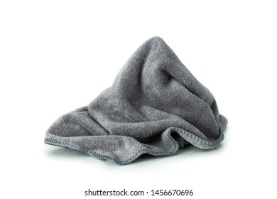 Microfiber cloth isolated on pure white background. Dirty rag made from soft fabric with cleaner equipment.