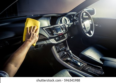 Microfiber and console car, Hand cleaning Interior modern car, Microfiber and cleaning solution to clean. copy space.