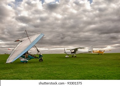 microlight and planes on a grass field