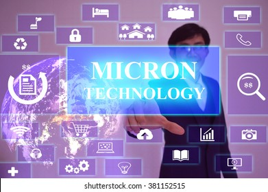 MICRON TECHNOLOGY  concept  presented by  businessman touching on  virtual  screen ,image element furnished by NASA