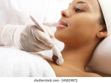 Microneedle mesotherapy, treatment neckline, the woman at the beautician
