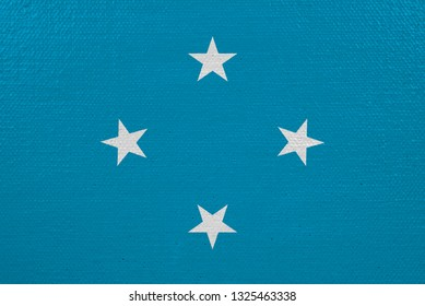 Micronesia flag on canvas. Patriotic background. National flag of Micronesia