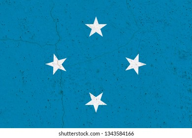 Micronesia flag on concrete wall. Patriotic grunge background. National flag of Micronesia