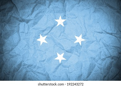 Micronesia flag on crumpled paper