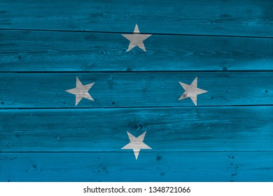 Micronesia flag painted on old wood plank. Patriotic background. National flag of Micronesia
