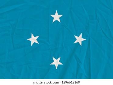 Micronesia grunge flag. Patriotic background. National flag of Micronesia