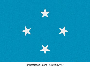 Micronesia paper flag. Patriotic background. National flag of Micronesia