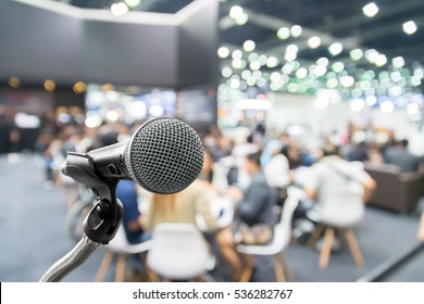 Microphone with abstract blurred photo of conference hall or seminar room with attendee and bokeh, Business meeting concept.