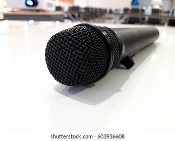 Microphone with abstract blurred photo of conference hall or seminar room, Business meeting concept.