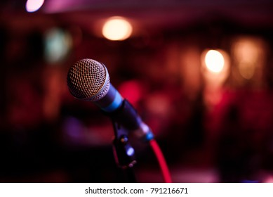 microphone against and music notes blur colorful light background