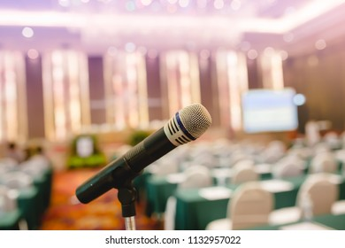 Microphone in an auditorium for shareholders' meeting or seminar event.