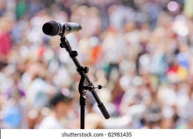 Microphone awaiting the next performer at an outdoor concert on a sunny summer afternoon in UK