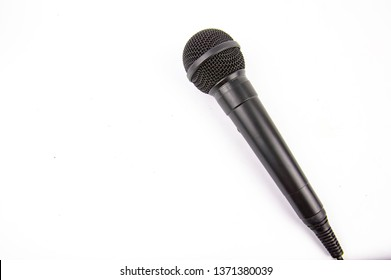 Microphone black on a white background. Place for text.
