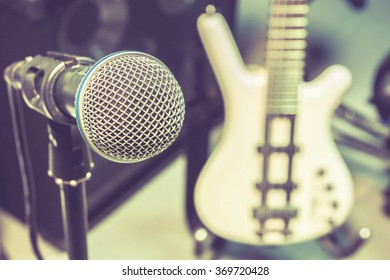 microphone, blur electric bass background.