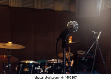 Microphone and blur musical equipment drum background.