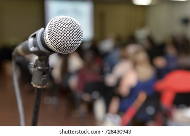 microphone with a blurred background audience