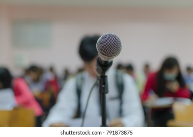 Microphone with blurred background of people