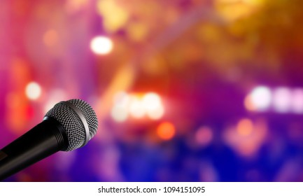 Microphone with blurred colorful bright light in dark night background, soft focus image for business technology communication concepts