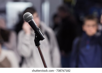 Microphone at blurred event background