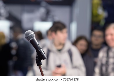Microphone at blurred people background