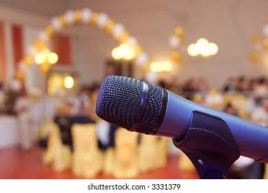 Microphone close up in a celebratory room