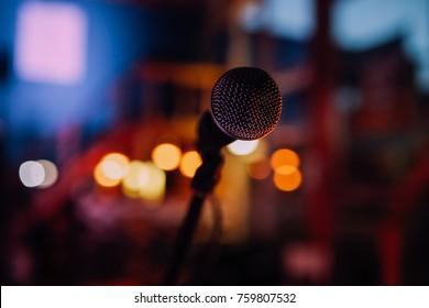 Microphone close up in a empty dark night club