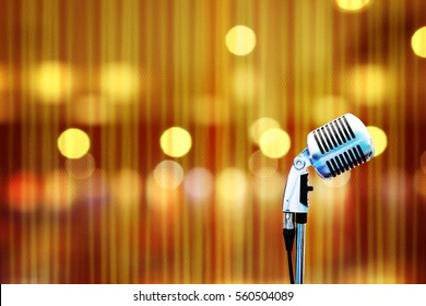Microphone in concert hall with night light bokeh blur background
