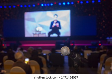 Microphone in conference hall or seminar room with attendee background, Business meeting concept