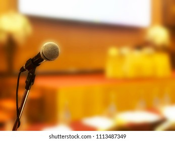 Microphone in the conference room with the blurred background.