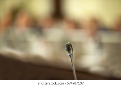 Microphone in conference room or seminar meeting room in business event. Speaker mini mic. Session of Government. Academic classroom training course in lecture hall. blur abstract background luxury