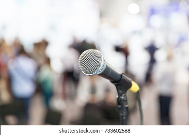 Microphone in focus against blurred audience. Press conference.