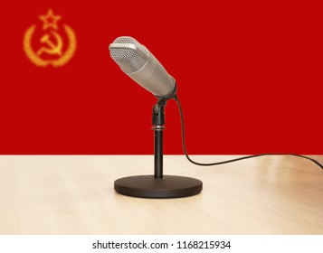 Microphone in front of the flag of