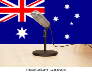 Microphone in front of the flag of Australia