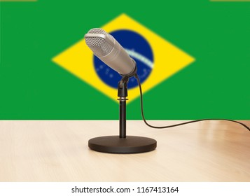 Microphone in front of the flag of Brazil