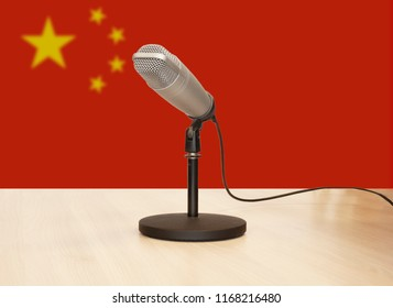 Microphone in front of the flag of China