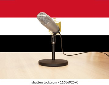 Microphone in front of the flag of Egypt