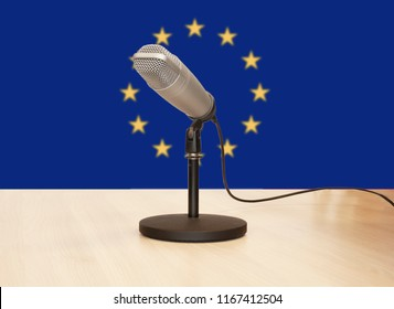 Microphone in front of the flag of Europe