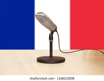 Microphone in front of the flag of France